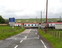 A southbound Virgin Voyager thunders through the former Auchengray station and over the level crossing on 28 June 2007 on a Glasgow Central - Plymouth Cross Country service.<br><br>[John Furnevel&nbsp;28/06/2007]