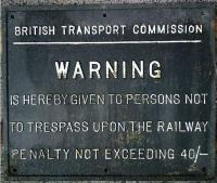 British Transport Commission trespass warning sign. Rectangular metal sign (probably black background with white lettering and border) located at the site of Abercorn Station, Paisley on the Paisley & Renfrew line. Bearing the legend - British Transport Commission - WARNING - Is hereby given to persons not to trespass upon the Railway - Penalty not exceeding 40s.<br><br>[Alistair MacKenzie&nbsp;15/01/1980]
