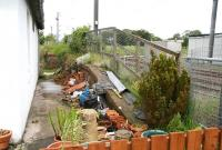 Platform remains alongside the former station building at Auchengray in June 2007 - looking towards Edinburgh from the level crossing. <br><br>[John Furnevel&nbsp;28/06/2007]