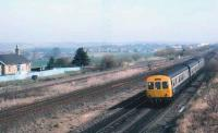 A class 101 DMU going up the branch to the Upper box at Greenhill. The former station house to the left.<br><br>[Brian Forbes&nbsp;/03/1989]