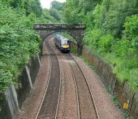 An Edinburgh Waverley - Glasgow Queen Street shuttle service in the cutting approaching the site of Philpstoun station on 7 July 2007.<br><br>[John Furnevel&nbsp;07/07/2007]
