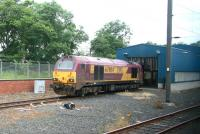EWS 67004 <I>Post Haste</I> standing outside the wheel lathe shed at Craigentinny depot on 5 July 2007. Photographed from a passing train.<br><br>[John Furnevel&nbsp;05/07/2007]