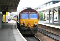 A pair of class 66 locomotives taking an empty ballast train from Waverley past the coffee kiosk on Haymarket platform 2 on 6 July 2007. The train turned south onto the <I>sub</I> at Haymarket Central Junction. <br><br>[John Furnevel&nbsp;06/07/2007]