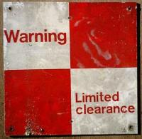 Metal enamelled sign, red and white quartered, legend Warning - Limited clearance. On road bridge carrying New Bridge Street over disused Lanarkshire and Dumbartonshire Railway.<br><br>[Alistair MacKenzie&nbsp;08/02/1980]