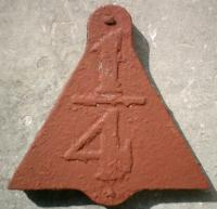 <B>1/4 MP sign </B>Triangular metal plate with bolt projections top and bottom and low relief numerals 1/4 of black figures on white. Found on timber post lying at foot of embankment of GD&H line at jct with Castlegreen sidings.<br><br>[Alistair MacKenzie&nbsp;06/03/1980]