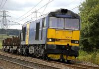 Blue liveried EWS 60078 near Curriehill on 10 July with the Dalziel-Lackenby steel empties.<br><br>[Bill Roberton&nbsp;10/07/2007]