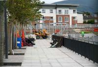 Tree-lined pedestrian access to Alloa station on 10 July with the framework for the new station building straight ahead.<br><br>[John Furnevel&nbsp;10/07/2007]