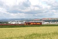 66236 with a ballast train in front of the terminal building at Edinburgh Airport on 8 July 2007 with a memento of the former West Lothian shale oil industry standing in the background. <br><br>[John Furnevel&nbsp;08/07/2007]