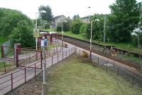 Entrance to Corkerhill station on the Paisley Canal line in May 2007. View east towards Corkerhill depot from where the electrified headshunt runs. The original 1896 G&SW <i>railway village</I> (demolished and cleared by 1971) stood to the right of the picture.<br><br>[John Furnevel 20/05/2007]