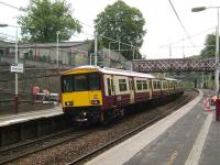 Eastbound service pauses at Cambuslang on 17 July.<br><br>[David Panton&nbsp;17/07/2007]