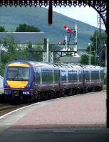 170415 with the 1431 service to Inverness departing Aviemore past the semaphore signals at the north end.<br><br>[Graham Morgan&nbsp;06/07/2007]