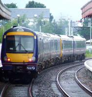 170396 at the rear of a two unit set with a Class 158 at the front departing Aviemore with the 1630 service for Inverness<br><br>[Graham Morgan&nbsp;06/07/2007]