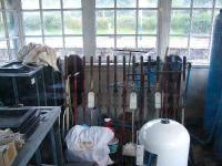 Inside the signal box,surrounded by clutter,the lever frame and levers.<br><br>[John Gray&nbsp;20/07/2007]