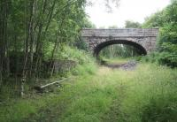 Trackbed and remains at Alyth Junction on 12 July 2007. View is North East through the road bridge carrying the B954 north towards Alyth.<br><br>[John Furnevel&nbsp;12/07/2007]