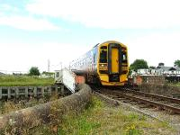 158705 crosses the swing bridge at Clachnaharry on its way to Kyle of Lochalsh.<br><br>[John Gray&nbsp;23/07/2007]