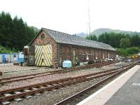 Despite one author writing that it had been demolished in 1998, the former engine shed at Crianlarich is still standing and is now part of a maintenance complex surrounded by portacabins.<br><br>[John Gray&nbsp;20/07/2007]