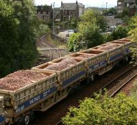 <I>More ballast anyone?</I> ...another load waiting to move up to the works site stretches back over Inverkeithing South Junction while the branch to Rosyth dockyard meanders off down the hill.<br><br>[John Furnevel&nbsp;24/07/2007]