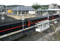 Old and new station buildings stand side by side at Markinch on 22 July as a southbound service pulls in.<br><br>[John Furnevel&nbsp;22/07/2007]