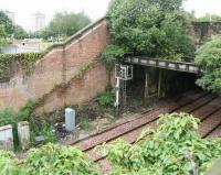 Site of the former Sinclairtown station on 22 July 2007 showing the remains of the booking office base and the line of the old stairway. Note also the blocked up doorway (top right) that once provided access from St Clair Street. View south towards Kirkcaldy town centre.  <br><br>[John Furnevel&nbsp;22/07/2007]