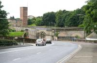 The surviving bridge abutments, embankment and arches are all part of the branch that once served Kirkcaldy Harbour (off picture to the left). View south along the A921 towards the Town Centre on 22 July 2007, with the former Nairns Linoleum factory in the background.<br><br>[John Furnevel&nbsp;22/07/2007]