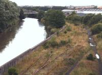 View west along the banks of the River Leven on 26 July 2007 showing the rusting and overgrown lines that once brought the coal into the docks at Methil.<br><br>[John Furnevel&nbsp;26/07/2007]