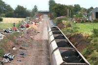 Looking south from Dornock on 3 August showing preparatory work in connection with the redoubling of the line as a coal train heads towards Gretna.<br><br>[John Furnevel&nbsp;3/08/2007]