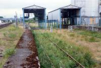 Abandoned grain silo sidings at Muir of Ord looking north 1n 1989. Note Muir of Ord North signalbox in the left background.<br><br>[Ewan Crawford&nbsp;//1989]