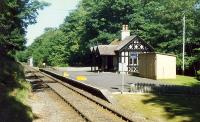 The second station building at Dunrobin looking north. The little shed in the distance to the right of the railway was used to hold the Dukes carriage. The shed has since been demolished, but the disused bay platform at the north end remains.<br><br>[Ewan Crawford&nbsp;//1989]