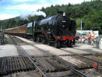 Schools class 30926 <I>Repton</I> brings a rake of LNER coaches south over the level crossing into Levisham on the NYMR on 31 July. <br><br>[John McIntyre&nbsp;31/07/2007]