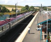 Edinburgh bound Voyager leaves Alnmouth. The former shed and platform for the Alnwick branch stood on the other side of the wooden fence. <br><br>[John Furnevel&nbsp;16/08/2007]