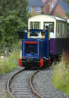 Barclay locomotive with a train on the Almond Valley narrow gauge line, Livingston.<br><br>[Bill Roberton&nbsp;15/08/2007]