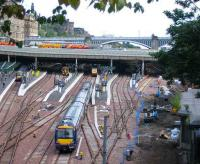 With engineering work ongoing and platform space at a premium, a First ScotRail arrival slowly approaches 14, where a Voyager has left just enough space.<br><br>[John Furnevel&nbsp;17/08/2007]