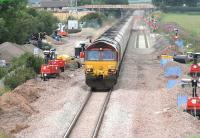 A southbound coal train runs south through Dornock on 3 August past the junction for the munitions sidings at Eastriggs with engineering work in progress in connection with the redoubling of the Gretna - Annan section.<br><br>[John Furnevel&nbsp;03/08/2007]