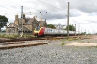 View north west across the site of Belford station on 16 August 2007 with a Voyager passing en route to Waverley. The station closed to passengers in January 1968. [See image 16269]<br><br>[John Furnevel&nbsp;16/08/2007]