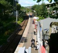 Passengers wait for a delayed Glasgow train at Branchton on 29 July 2007. View west towards Wemyss Bay.<br><br>[John Furnevel&nbsp;29/07/2007]
