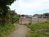 The trackbed of the North Sunderland Light Railway entering the former terminus at Seahouses in the summer of 2007. The site, that once accommodated the station, goods yard and locomotive shed, is now the main car park for the village. [See image 16293]<br><br>[John Furnevel&nbsp;18/08/2007]