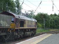 66164 passing through Johnstone heading west in the direction of Hunterston for more coal<br><br>[Graham Morgan&nbsp;30/08/2007]