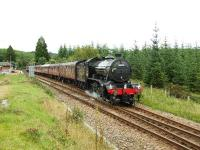 61994 accelerates away from Tulloch. Crossing Rannoch Moor has not done the floral wreath any good and its battered remains hang from the smokebox door.<br><br>[John Gray&nbsp;01/09/2007]