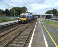 185148 stops at the down slow platform at Leyland on 25 August with a service to Blackpoool North.<br><br>[John McIntyre&nbsp;25/8/2007]