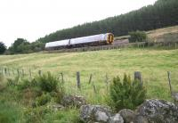 The early morning train from Wick/Thurso bound for Inverness on 30 August 2007, seen here running along the southern slopes of Strathfleet shortly after leaving Rogart.<br><br>[John Furnevel&nbsp;30/08/2007]
