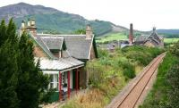 <I>And you couldn't wish for better neighbours... </I> Looking west beyond the old Edderton station in August 2007 towards the Balblair distillery dating from 1790.<br><br>[John Furnevel&nbsp;30/08/2007]