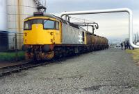 <I>Go on son, you drive it out. We cant be bothered</i>. 26 with molasses tanks at the United Molasses Depot, James Watt Dock.//16472,16476,16474,16475,16455,16477<br><br>[Ewan Crawford&nbsp;//1988]