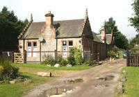 Approaching the forecourt of the former Highland Railway station at Moy on 1 September 2007. The station was opened in July 1897 and closed in May 1965 and is now used as self catering holiday accommodation.<br><br>[John Furnevel&nbsp;01/09/2007]