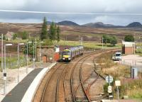 Heading north from Dalwhinnie on 25 August 2007 past the surviving water tank base and operational signal box.<br><br>[John Furnevel&nbsp;25/08/2007]