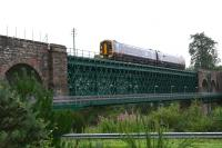 The 10.39 service from Inverness to the far north crosses the Oykel Viaduct towards Invershin station in August 2007. Note the pedestrian walkway attached to the side of the viaduct [see image 3272].<br><br>[John Furnevel&nbsp;30/08/2007]