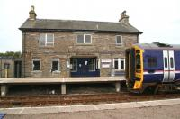 The station building at Georgemas Junction on 28 August 2007, with 158740 standing alongside awaiting its departure time for Inverness.<br><br>[John Furnevel&nbsp;28/8/2007]