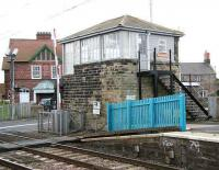 The level crossing and box at Chathill on 16 August 2007. The impressive building in the background with the portico entrance is the village post office. <br><br>[John Furnevel&nbsp;16/08/2007]