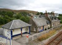 Calm before the storm. Looking over Lairg station from the footbridge on 31 August 2007 with the oil depot at the rear. The station buildings on the up side lie beyond the (staggered) platform.<br><br>[John Furnevel&nbsp;31/8/2007]