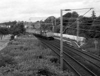 A Glasgow bound service off the West Highland Line passes through Cardross in July 1986. <br><br>[John McIntyre&nbsp;15/07/1986]