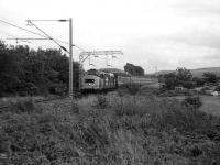 Class 37 with a train for the West Highland Line approaching Cardross in July 1986.<br><br>[John McIntyre&nbsp;15/07/1986]